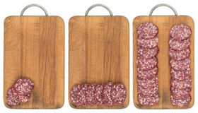 Sliced salami sausage on a cutting board. Isolated on white back Royalty Free Stock Image