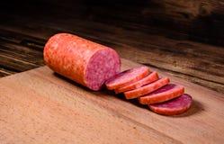 Sliced salami sausage on cutting board. Sliced salami sausage on a cutting board Stock Images