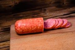 Sliced salami sausage on cutting board. Sliced salami sausage on a cutting board Stock Image