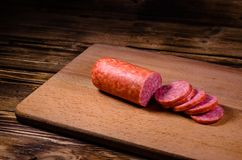 Sliced salami sausage on cutting board. Sliced salami sausage on a cutting board Royalty Free Stock Photography