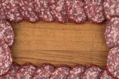 Sliced salami sausage on a cutting board. Royalty Free Stock Photography