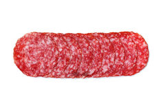 Sliced salami on a white. Close up. Isolated on white Stock Image