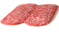 Sliced salami on a white. Close up. Isolated on white Stock Photo