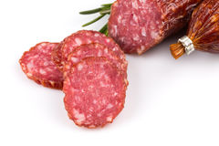 Sliced salami on white Stock Image