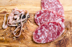Sliced salami on a wood board Stock Images