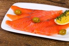 Sliced salmon with lemon Stock Photos