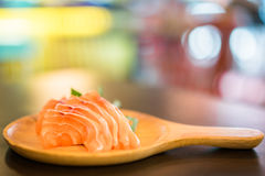 Sliced salmon sashimi served on wooden platter, Japanese food delicious menu, bokeh blurred background with copy space Stock Photos