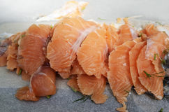 Sliced salted salmon fillet on paper Stock Images