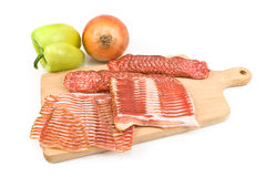 Sliced sausage and bacon  on wooden board Stock Image