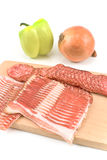 Sliced sausage and bacon  on wooden board Stock Photos