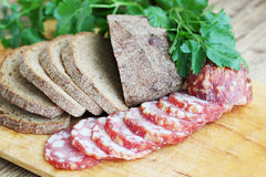 Sliced sausage with bread Royalty Free Stock Photos