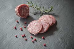 Sliced sausage on chalkboard background Stock Images