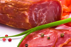 Sliced Sausage closeup. Sliced Sausage, Bell Pepper, Pepper and Chives Stock Images