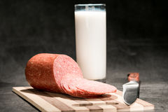 Sliced sausage on cutting board Stock Images