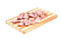 Sliced sausage on cutting board Stock Photography