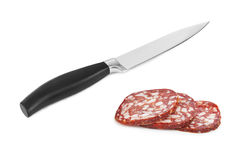 Sliced sausage and knife Stock Photos