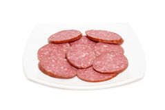 Sliced sausage on the plate Stock Photography