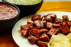 Sliced sausage with sauces. Sliced sausage on a white plate with sauces Royalty Free Stock Photo