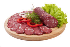 Sliced sausage with vegetables Stock Images
