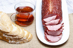 Sliced sausage on wooden table Royalty Free Stock Image