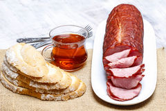 Sliced sausage on wooden table Royalty Free Stock Images