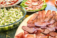 Sliced sausages and cocktail bites Royalty Free Stock Photo