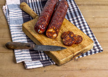 Sliced sausages. On a cutting board stock photography