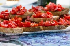 Sliced seasoned tomato on bread Royalty Free Stock Images