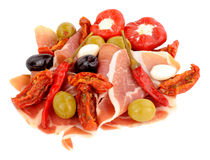Sliced Serrano Ham With Olives And Peppers Stock Image