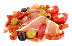 Sliced Serrano Ham With Olives And Peppers Stock Photo