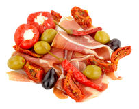 Sliced Serrano Ham With Olives And Peppers Royalty Free Stock Photo