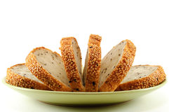 Sliced Sesame Bread On White Background royalty free stock photos