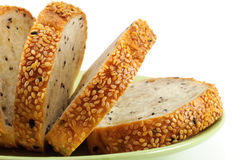 Sliced Sesame Bread On White Background stock images