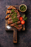 Sliced Sirloin steak with chimichurri sauce Royalty Free Stock Images