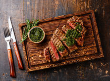 Free Sliced Sirloin Steak With Chimichurri Sauce Stock Photography - 66396292
