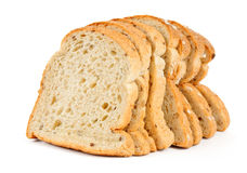 Sliced släntrar av wheaten bröd arkivfoton