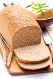Sliced   slow-baked organic wholemeal bread with butter and rosem Stock Images