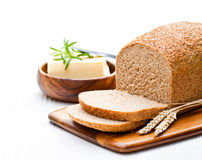 Sliced   slow-baked organic wholemeal bread with butter and rosem Royalty Free Stock Photos