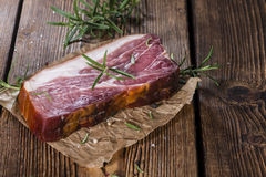 Sliced Smoked Ham. With some fresh herbs on rustic wooden background Stock Photography