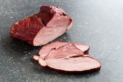 Sliced smoked pork meat Stock Images
