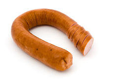 Sliced smoked sausage over white Royalty Free Stock Photo