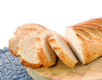 Sliced sour dough bread. On a bread board with white background Stock Photography