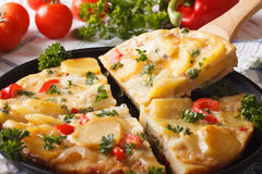 Sliced Spanish omelette with fried potatoes. Horizontal closeup Stock Photos