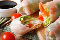 Sliced the spring rolls with shrimp, vegetables and sauce� Stock Image