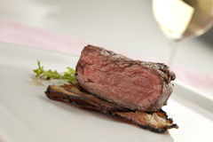 Sliced steak. Sliced beefsteak with bacon, salad and wine stock photos