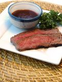 Sliced Steak. On a plate with barbecue sauce Royalty Free Stock Photo