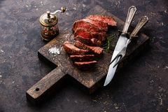 Sliced steak with knife and fork Stock Images