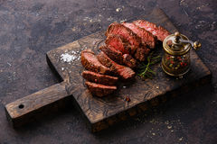 Sliced steak and pepper mill Stock Photography