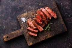 Sliced steak roastbeef and rosemary Royalty Free Stock Photo