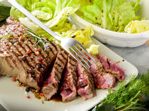 Sliced steak with  salad. Sliced steak with green salad Stock Image